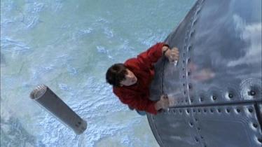Clark alcança um míssil para detê-lo: escalada de heroísmo.