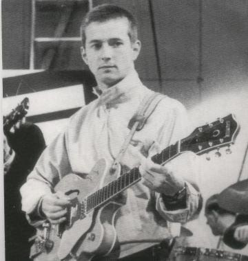 Um Eric Clapton adolescente e sua guitarra, começando a carreira.