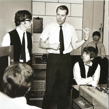 Instruindo os Beatles na sala de controle de Abbey Road.